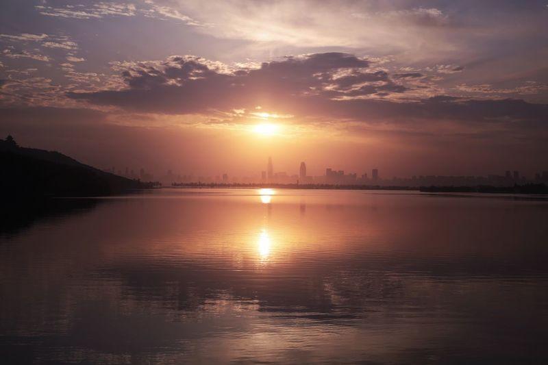 武汉出差ing… Reflection Sunset Water Sky Sun Beauty In Nature Scenics Nature Tranquility No People Tranquil Scene Silhouette Waterfront Outdoors Cloud - Sky Sea Day First Eyeem Photo