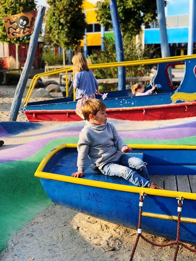 Childhood Child Playground Outdoor Play Equipment One Person Day Casual Clothing Boys Real People Park Slide - Play Equipment Playing