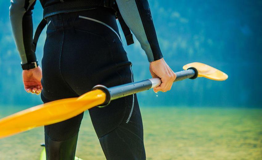 Man Holding Paddle