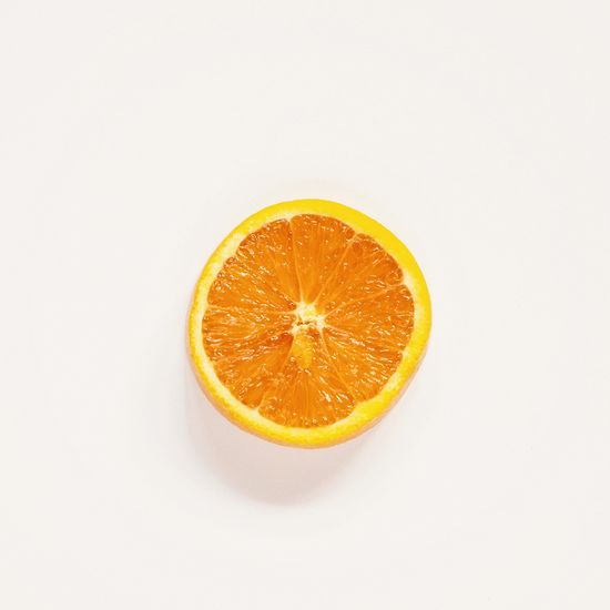 Orange slice Citrus Fruit Fruit Food And Drink Healthy Eating Food Orange Color Orange SLICE Freshness Studio Shot Orange - Fruit Indoors  Circle No People Shape Close-up