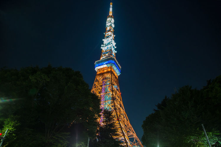 Tokyo Tower at night Tokyo Tokyo Tower Architecture Built Structure History Illuminated Low Angle View Night No People Outdoors Sky Tower Travel Destinations Tree