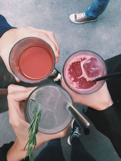 Cropped Image Of Friends Toasting Cocktails Outdoors