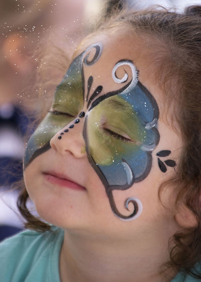 Close-up of cute girl with painted face