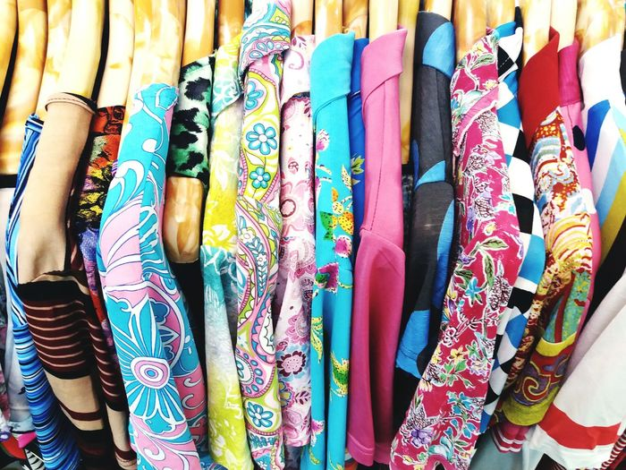 Close-up of colorful clothes for sale in store
