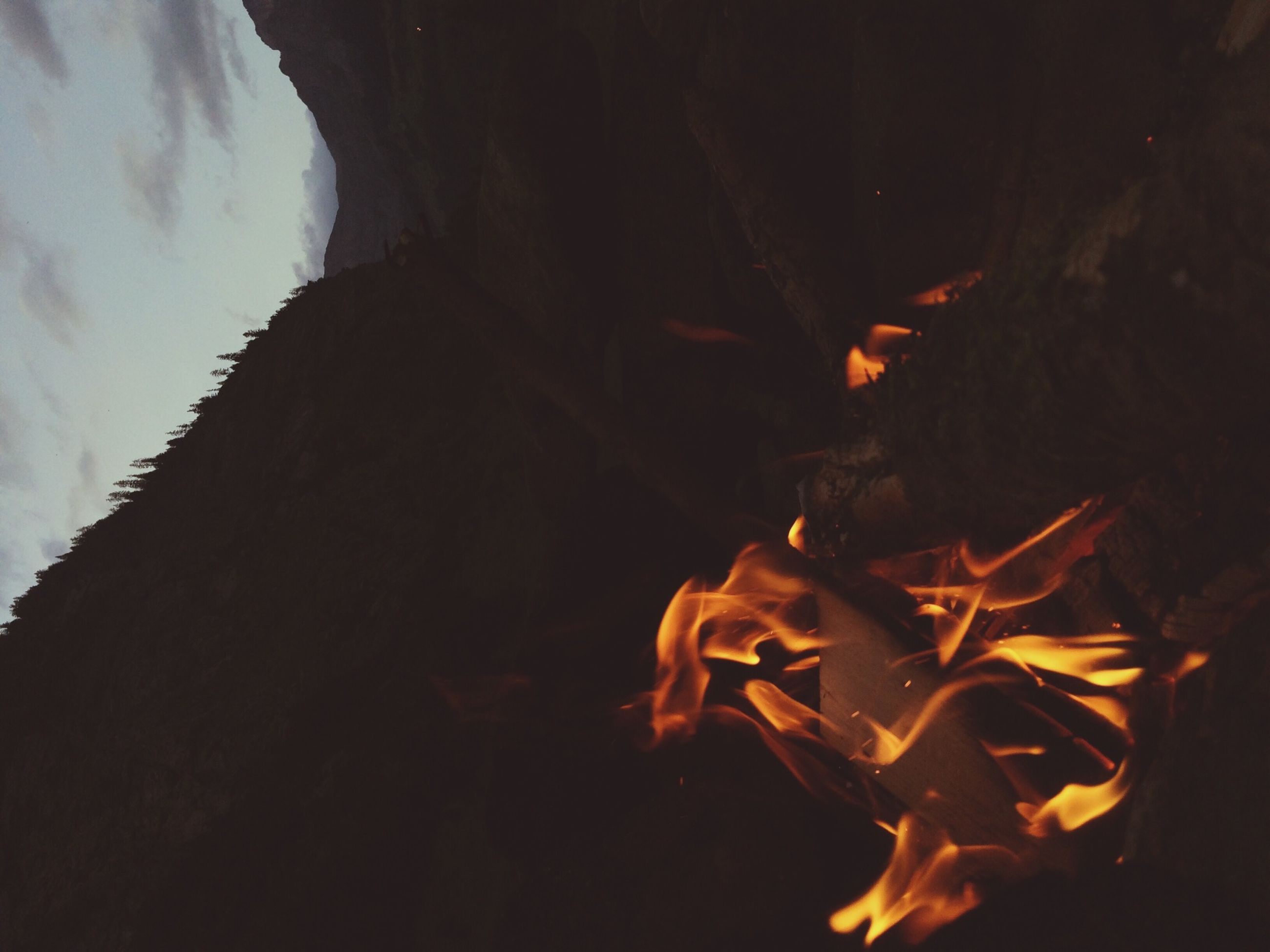 burning, flame, fire - natural phenomenon, heat - temperature, bonfire, night, fire, firewood, campfire, glowing, heat, close-up, orange color, dark, outdoors, rock - object, no people, motion, nature, light - natural phenomenon