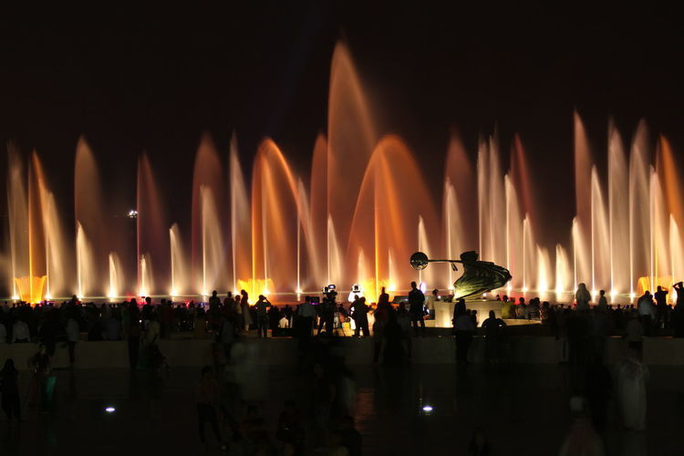 Illuminated Fountains At Event During Night