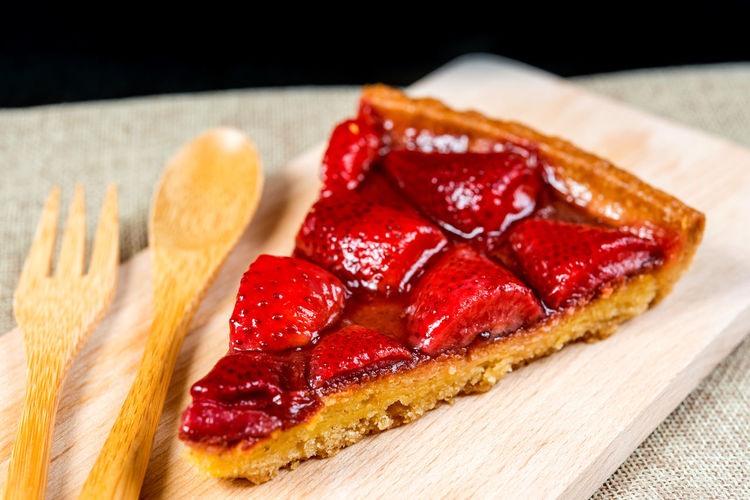 High Angle View Of Strawberry Tart Served On Cutting Board