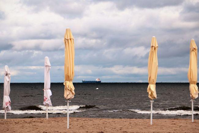Baltic Sea Poland Is Beautiful Sopot, Poland Closed Umbrellas Cloud - Sky Horizon Cargo Ship Outdoor Photography Scenics Tranquil Scene Travel Destinations Water Wawes