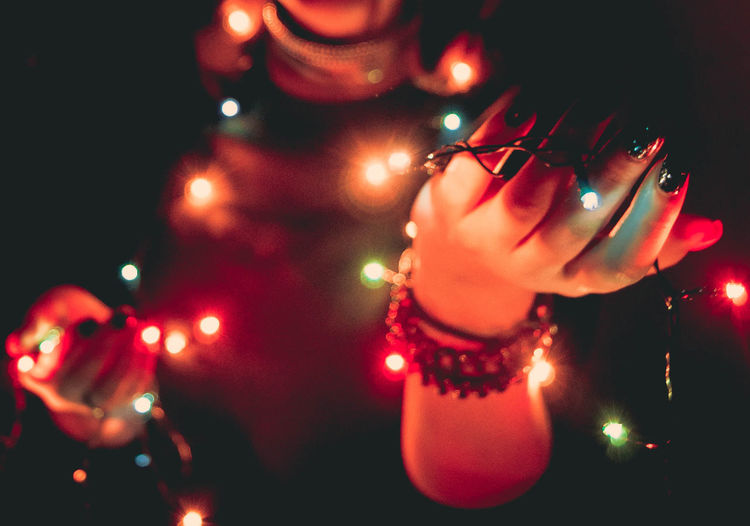 Christmas Decoration Illuminated Close-up Indoors  Night Christmas Lights One Person Only Men Young Adult Tree Defocused Human Hand