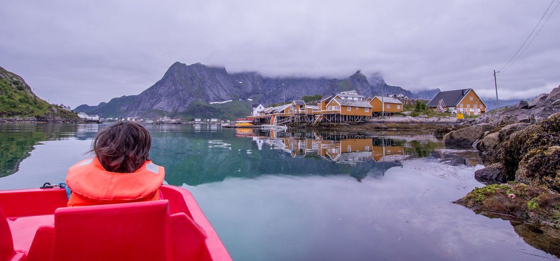 Norway Lofoten Islands Paddling Boating PrEsTiNe Beauty In Nature EyeEm Nature Lover Beach Leisure Activity Water Rear View Mountain Reflection Architecture Scenics - Nature Built Structure Lifestyles Looking At View Nature