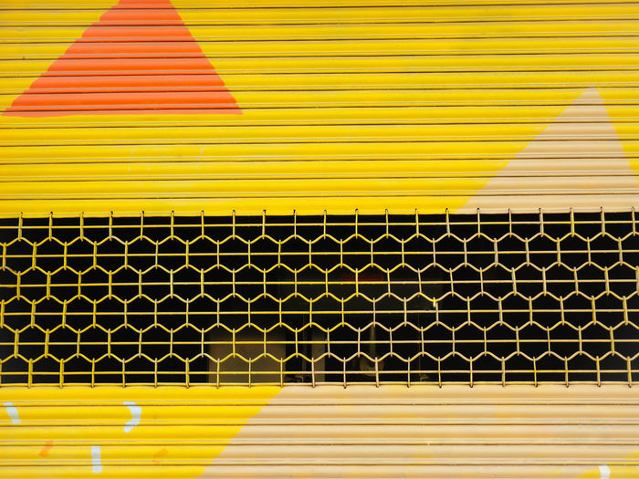 Colourful Shutter Streetphotography Street Art Street Art/Graffiti Yellow Neon Multi Colored Yellow Backgrounds Close-up Yellow Background LINE Detail Full Frame Marking Building Parallel Textured  Architectural Design