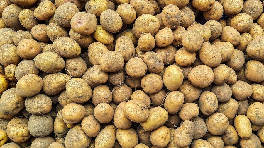 Full frame shot of potatoes for sale at market stall