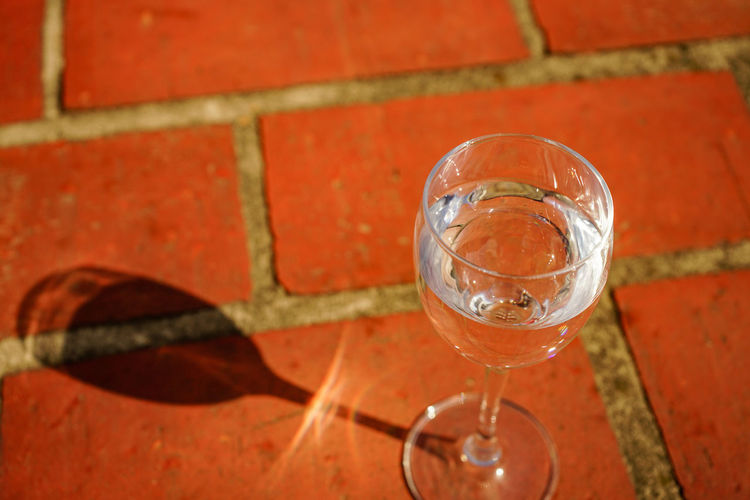 Close-up of wineglass on footpath