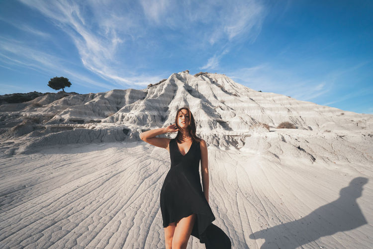 Full length of woman standing on ground against sky