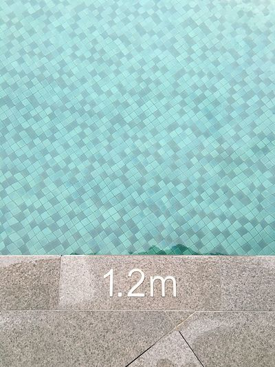 High Angle View Of Number On Poolside