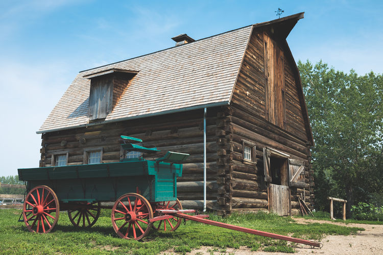 Barn Edmonton Architecture Building Building Exterior Built Structure Canada Cart Day Field Grass Green Color House Land No People Old Outdoors Simple Sky Vintage Wagon Wheel Wheel Wood - Material