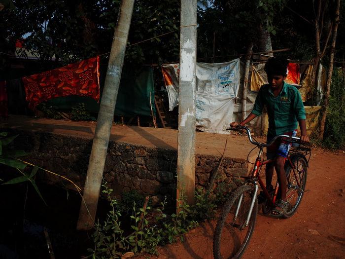 Man hanging on bicycle