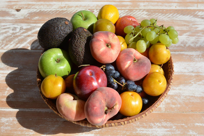 Basket of fresh fruit Apple Avocado Basket Of Fruit Day Food Fresh Fruit Freshness Fruit Fruit Basket Healthy Diet Healthy Eating Indoors  Multi Colored No People Peaches Plum Saturn Peaches Wood - Material Yellow Plums