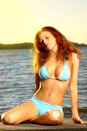 Beautiful young woman in bikini hair at beach