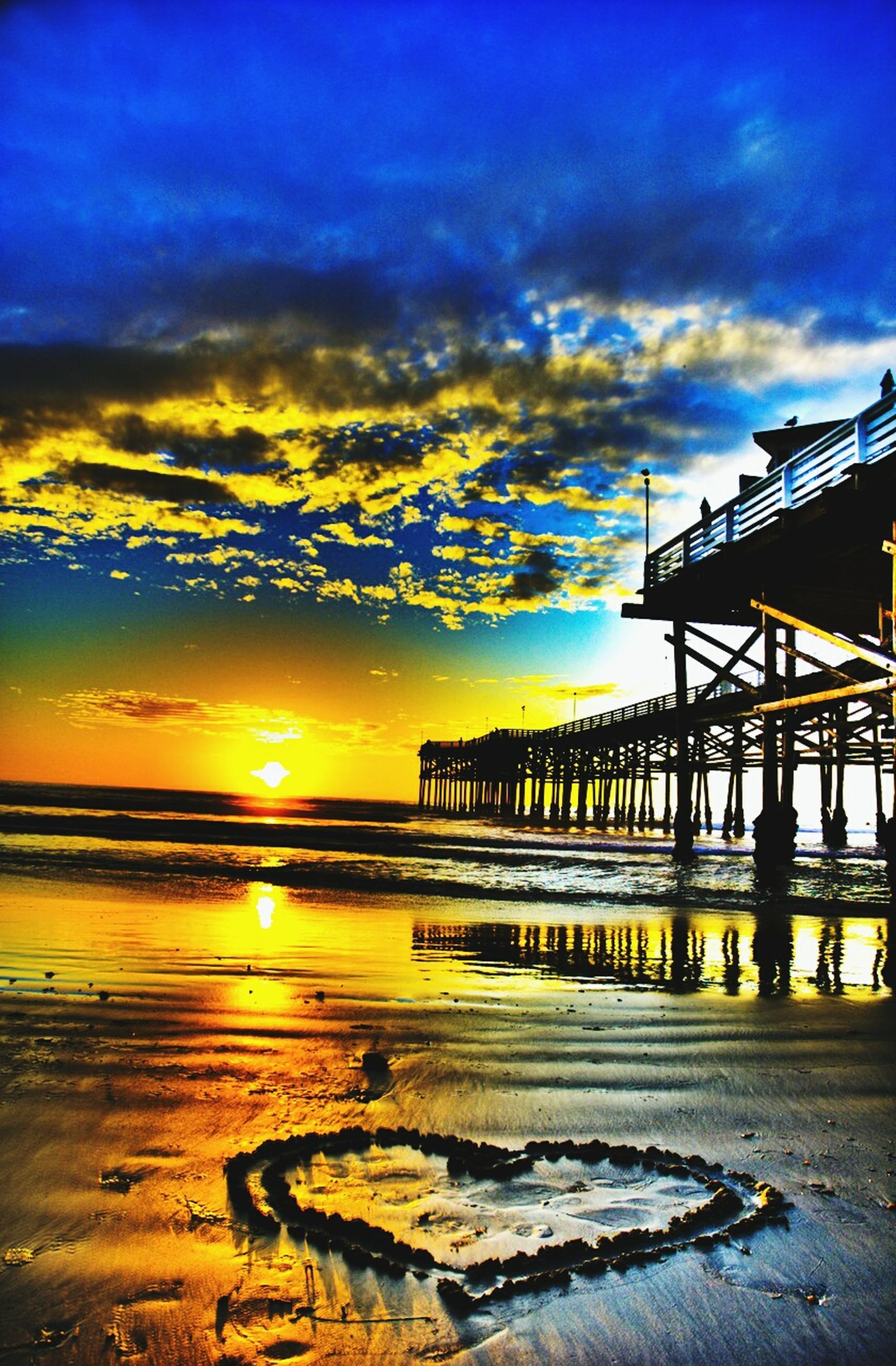 sunset, sky, water, cloud - sky, sea, horizon over water, orange color, built structure, scenics, beauty in nature, pier, beach, tranquility, nature, cloud, architecture, tranquil scene, reflection, shore, idyllic