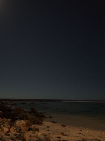 Sea Nature Beauty In Nature Horizon Over Water Tranquil Scene Tranquility Beach Scenics Water Sand Night No People Outdoors Sky Clear Sky The Week On EyeEm Lowlightphotography Longexposurephotography Moon Lights Up The Night in Maili, Oahu United States The Week On EyeEm