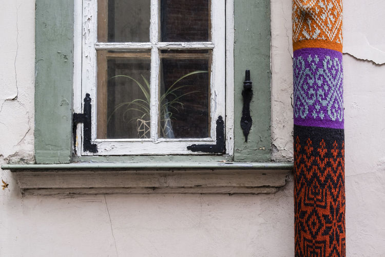 Yarn bombing in Riga, Latvia Architecture Art Blue Building Built Structure Close-up Closed Day Design Knitting Multi Colored No People Outdoors Window Wool Yarn Yarn Bombing