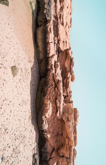 Oman Chapters Rock Day Rock Formation No People Nature Solid Rock - Object Sky Rough Tranquility Outdoors Geology Sunlight Close-up Physical Geography Textured  Low Angle View Beauty In Nature Pattern Brown Eroded