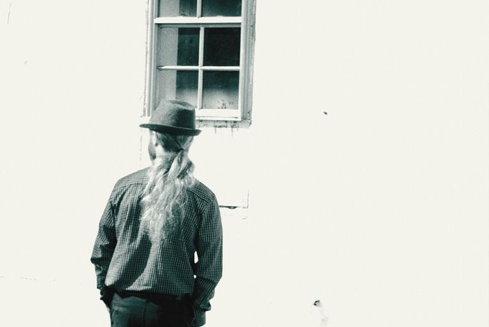 One Person One Man Only Only Men Young Adult Real People Day Adult People Outdoors Standing Alone Elegantly Dressed Top Hat Planning A Conference Vintage Grain Desaturated Black And White Theme Long Hair White Background Old Window