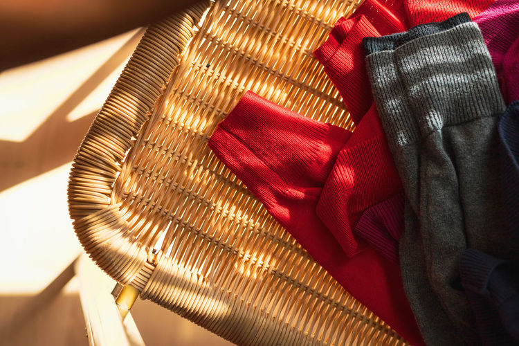 close-up of clothes at a chair Clean Close-up Clothing Comb Day Februar Focus On Foreground High Angle View Hygiene Indoors  Men Menswear Midsection One Person Pattern Personal Accessory Real People Red Selective Focus Still Life Sunlight Textile Warm Clothing My Best Photo