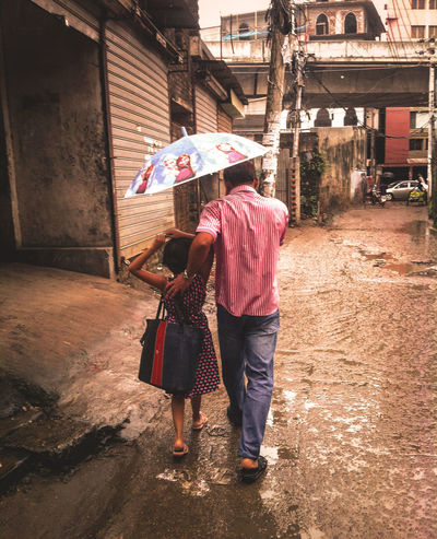 City Close-up Daughter Day Father Fatherhood Moments Full Length Mood Moody Outdoors People Rain Rainy Real People Rear View Togetherness Travel Destinations Two People Umbrella Warking Around Warmlight Women