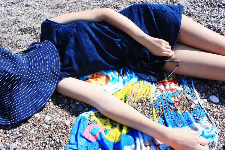 High Angle View Of Teenage Girl Relaxing On Beach