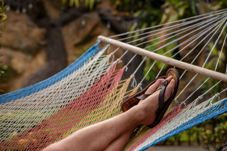 Low section of person relaxing in hammock