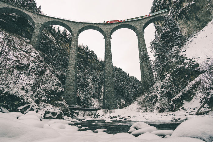 Glacier Express crossing the Landwasser viaduct in a beautiful winter scenery Architecture Architecture Beauty In Nature Bridge Bridge - Man Made Structure Cold Cold Temperature Glacierexpress Graubünden Landwasser Landwasser Viadukt  Nature Nature Outdoors Public Transportation River Schweiz Snow Structure Suisse  Swiss Switzerland Viaduct Viaducts Winter Shades Of Winter