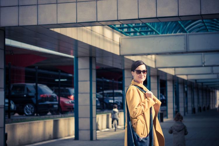 Portrait of woman walking in city