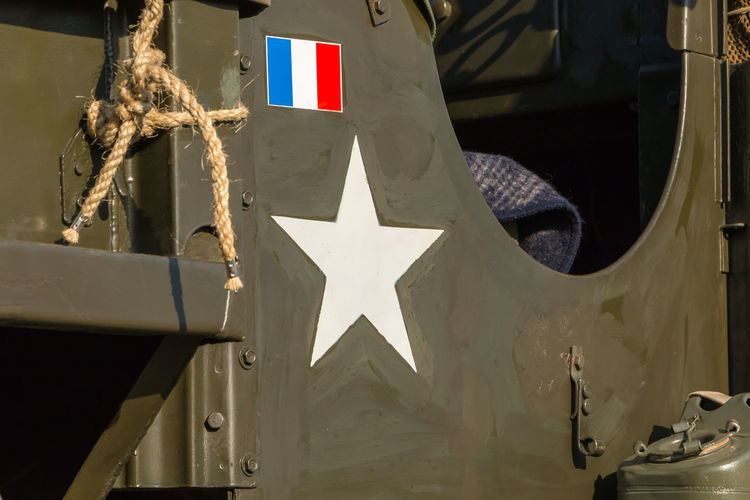 Close-up of flags hanging on metal structure