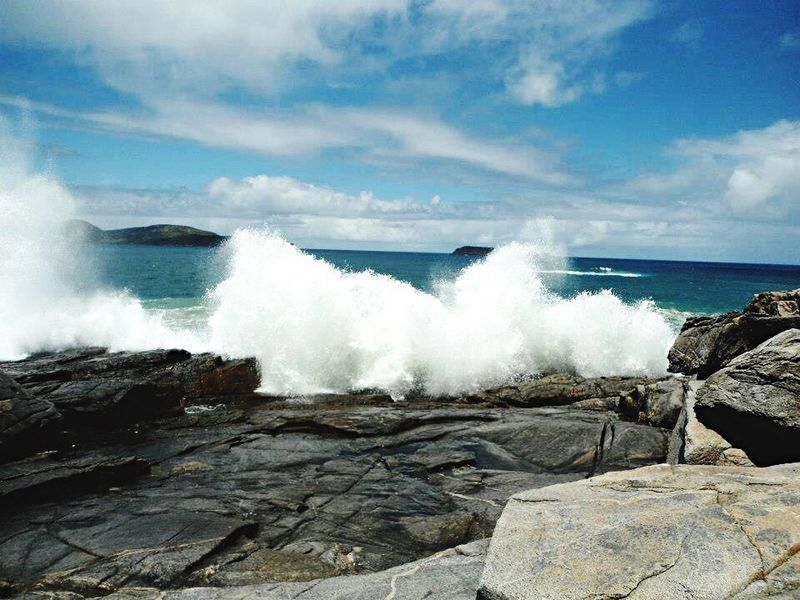 Sea Water Wave Rock - Object Surf Beach Sky Scenics Beauty In Nature Rock Formation Splashing Shore Rock Nature Rocky Tranquil Scene Power In Nature Day Outdoors Tranquility