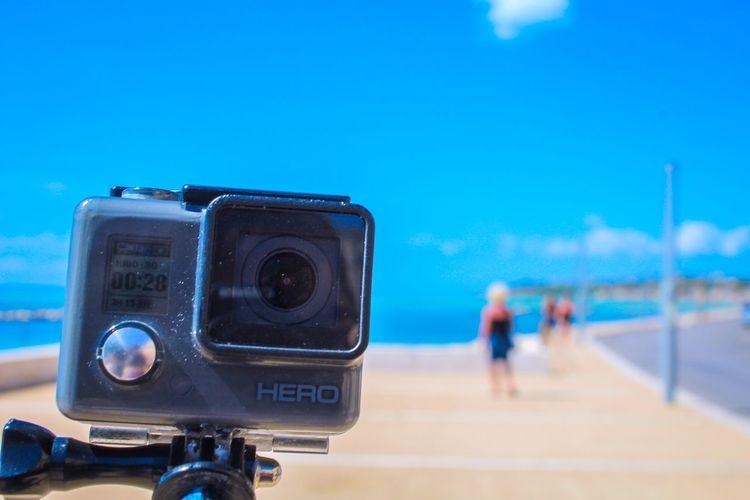 Close-up of camera against blue sky