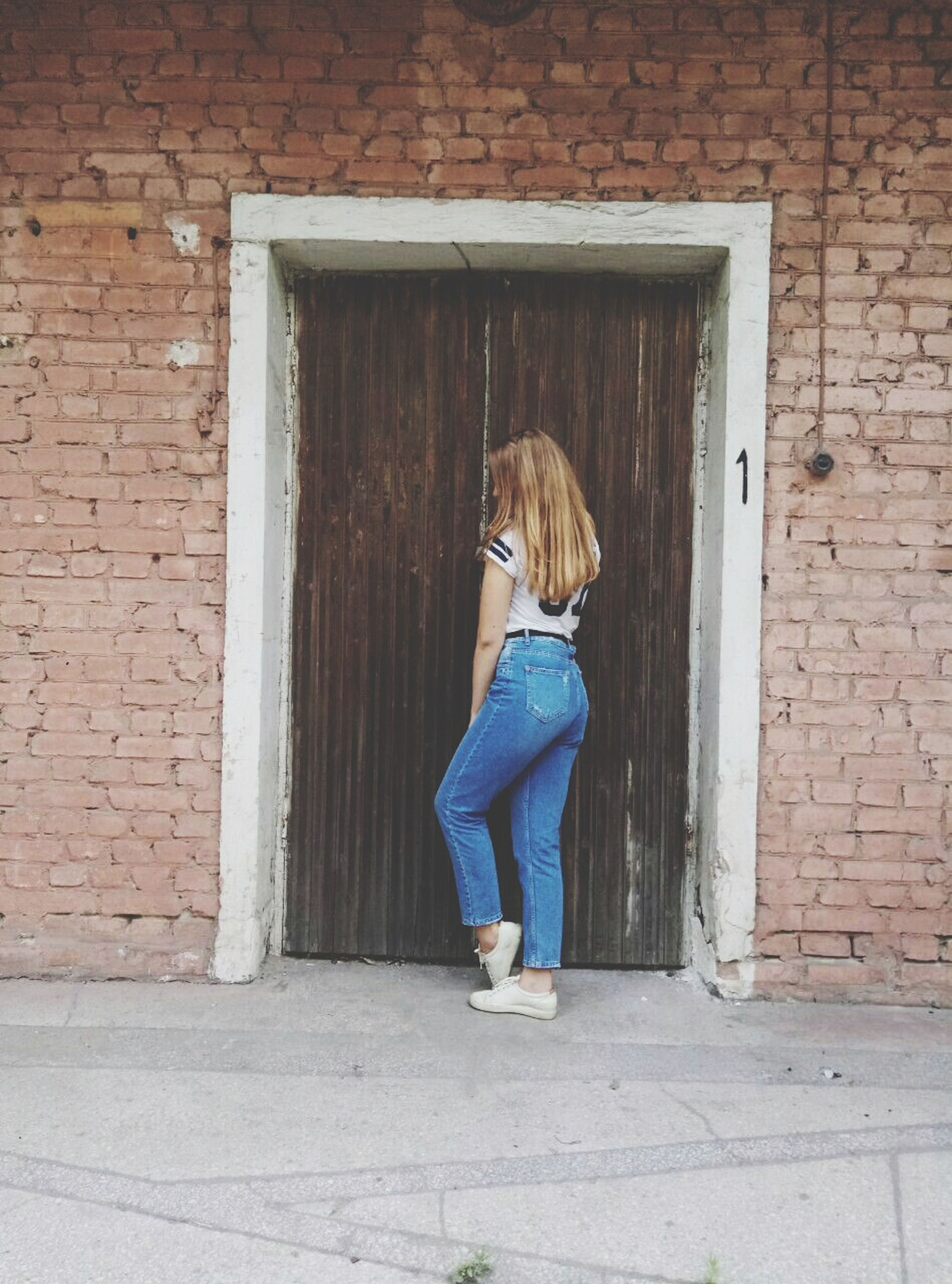 young adult, one person, full length, young women, real people, built structure, day, casual clothing, building exterior, outdoors, lifestyles, leisure activity, standing, architecture, women, beautiful woman, one young woman only, people