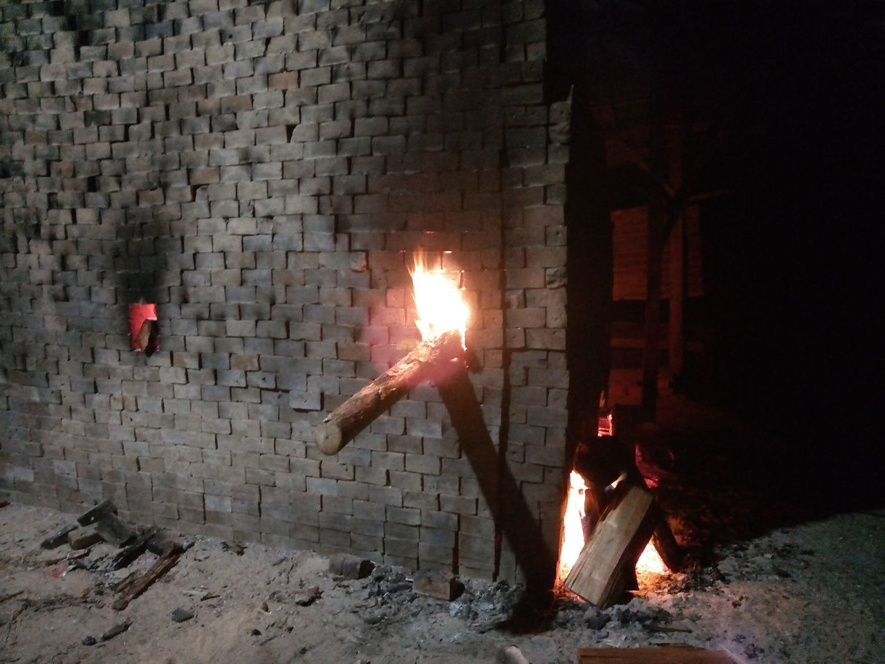 flame, fire, burning, fire - natural phenomenon, heat - temperature, glowing, nature, night, illuminated, firewood, motion, log, wood, architecture, built structure, no people, wood - material, environment, wall, fireplace, bonfire