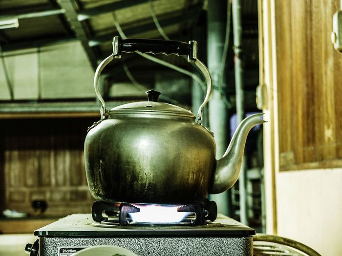 Close-Up Of Teapot On Stove