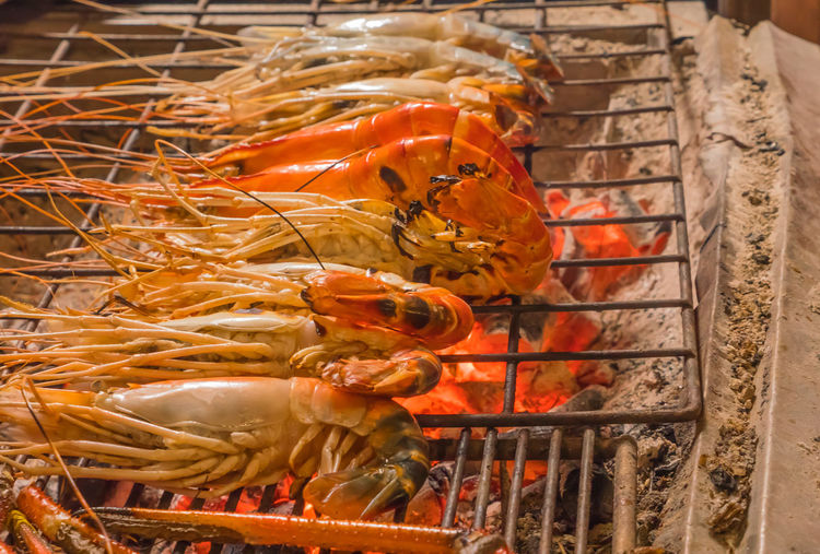 Abundance BBQ BIG Charcoal Chef Cinder Close-up Cooking Crayfish Grilled Heat - Temperature Kitchen Lobster Meal No People Orange Color Prawn Raw Food Red Retail  Sale Seafood Shrimp Stove Temprature