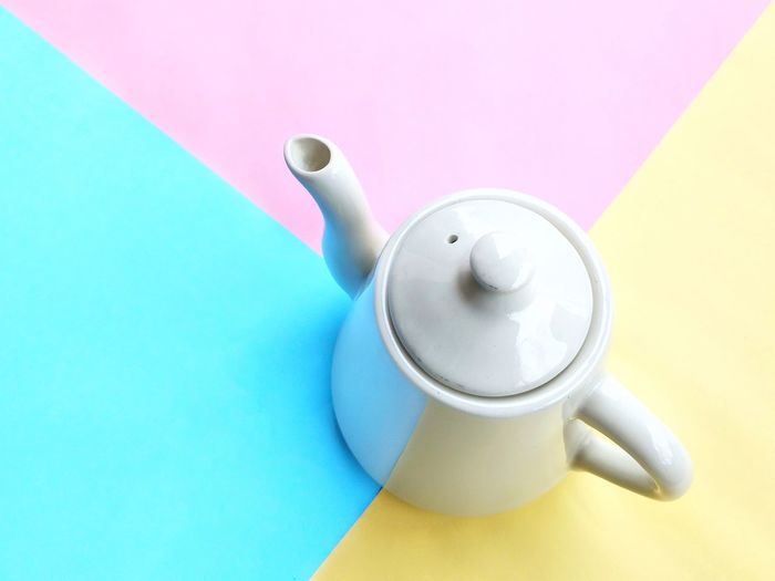 White ceramic teapot on pastel multicolored floor background, high angle view with copy space Ceramic Pastel Multicolored Colorful High Angle View Detail Space Pattern Texture Pink White Blue Yellow Modern Style Drink Tea - Hot Drink Coffee Break Frothy Drink Coffee - Drink Table Teapot Steam Teabag Coffee Cup Herbal Tea Ice Tea Coffee Pot Non-alcoholic Beverage Hot Drink