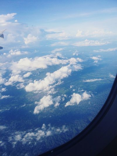 Sky And Clouds Airplane Flying Sea Water Airplane Wing Aerial View Blue Window Air Vehicle Sky