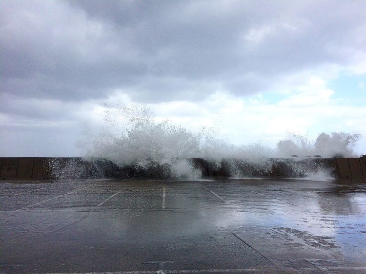 Parking Parking Lot No People Stormy Weather Ocean Spray Roaring Waves Power Of Nature Water Cloud - Sky Outdoors Noise Coast Sea And Sky Empty Emptiness Deserted Scapes Puddle Wet Concrete Asphalt