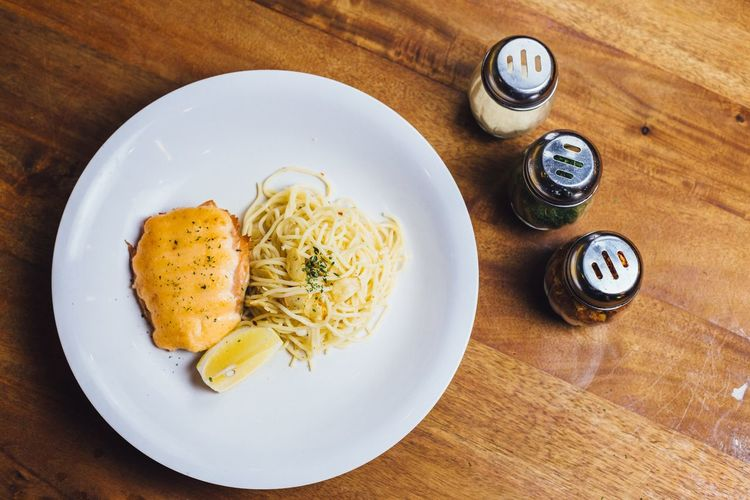 High angle view of salmon with pasta on table