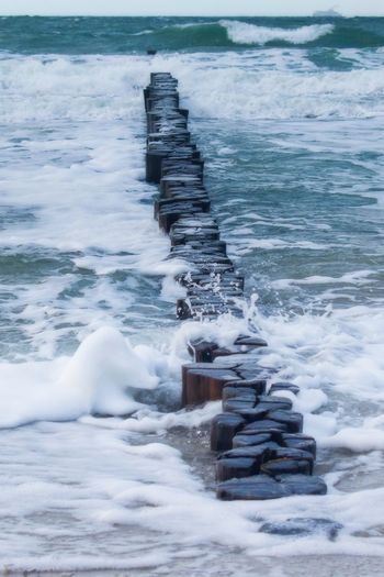 Flowing Power In Nature Blurred Motion Outdoors Land Flowing Water Long Exposure Solid Rock Day Scenics - Nature Sport Beauty In Nature Surfing Nature Wave Aquatic Sport Motion Sea Water Cold Temperature Winter