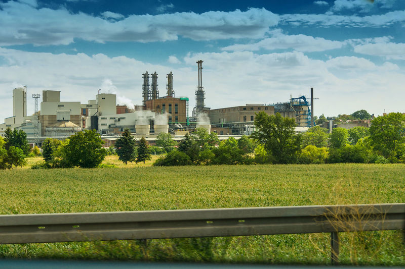 Power station near motorway in Germany Building Exterior Architecture Built Structure Sky Plant Factory Industry Cloud - Sky Nature Smoke Stack Day No People Outdoors Tree Growth Field Industrial Building  Grass Environment Building Pollution Air Pollution #NotYourCliche Love Letter