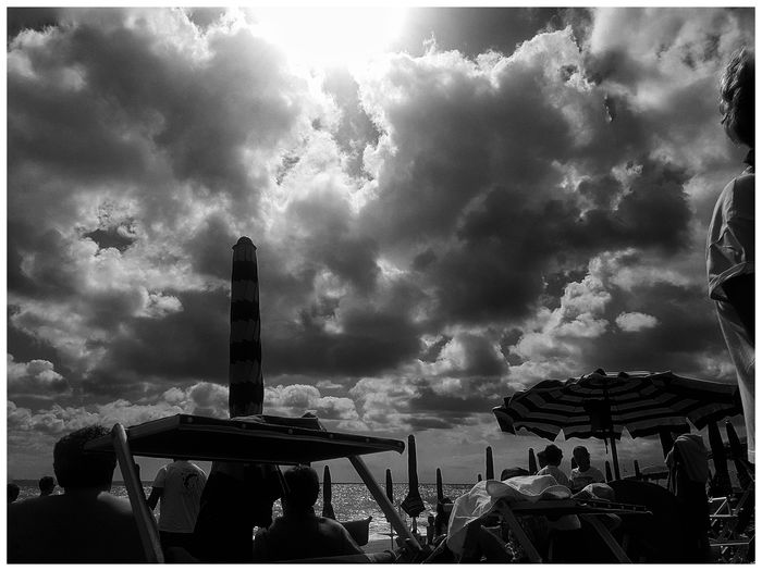 The dark side of the beach Clouds And Sky EyeEm Nature Lover Lights And Shadows Taking Pictures Relaxing Moments Atmosphere From My Point Of View Getting Creative Live For The Story Getting Inspired Hello World Beachphotography Summer Umbrellas Outdoors People Beauty In Nature Enjoing Life