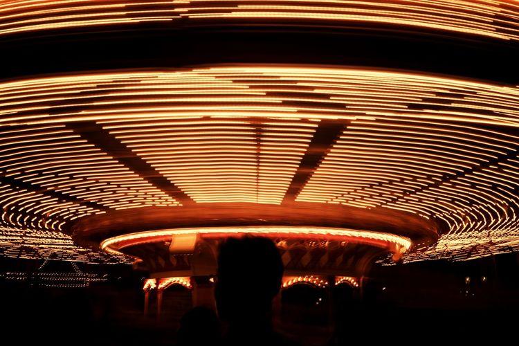 People at illuminated amusement park