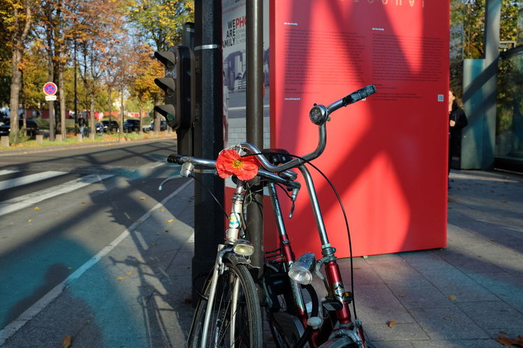 Bicycles Locked By Pole On Footpath In City